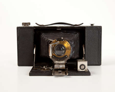 Antique bellows camera in front view isolated on white