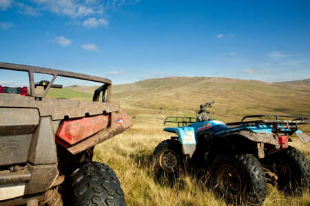 quad: Off road quad bikes on mountainside in remote Welsh valley