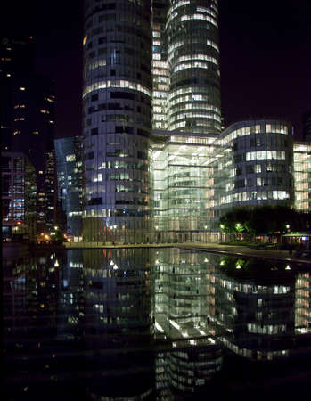 Modern skycraper office buildings reflected at night at La Defense in Paris photo