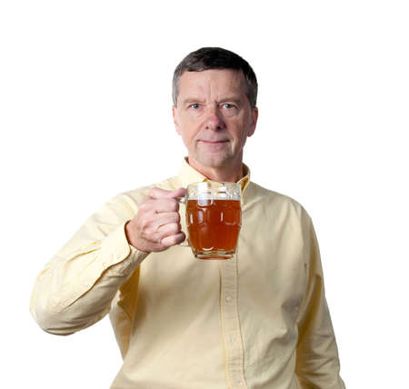 Senior male holding a pint of brown ale in english style mug and raising the drink in a greeting Stock Photo - 8069786
