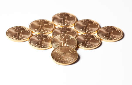 Solid gold eagle coins in the shape of a diamond