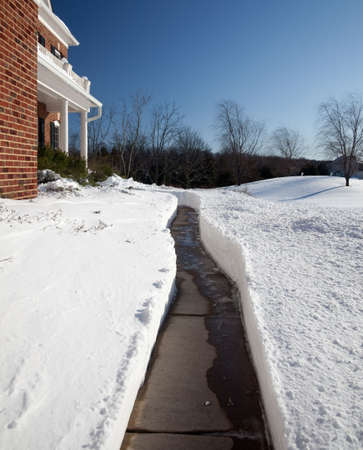 Pathway cut through deep snow towards the door of a modern single family home Stock Photo - 6119015