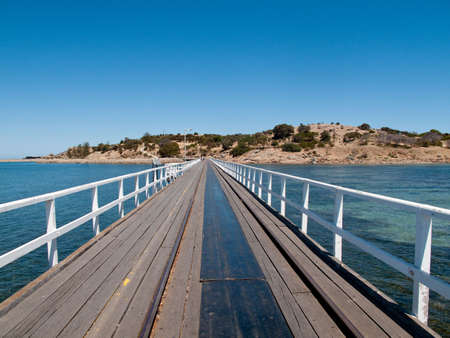 Wooden pier and railway track at Granite Island and Victor Harbor near Adelaide in Australia photo