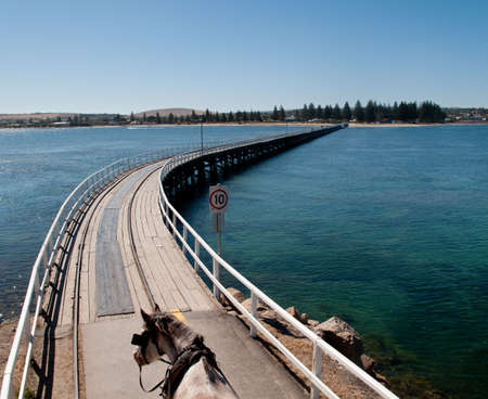 adelaide: Wooden pier and railway track at Granite Island and Victor Harbor near Adelaide in Australia