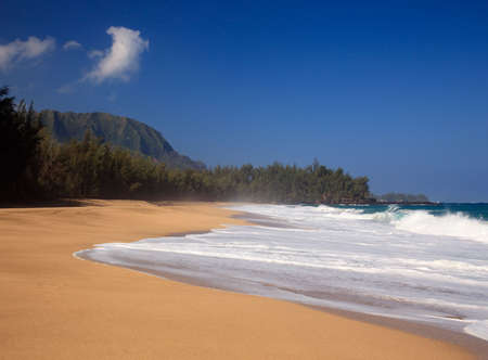 Strong waves crash over the beach at Lumahai on Kauai photo