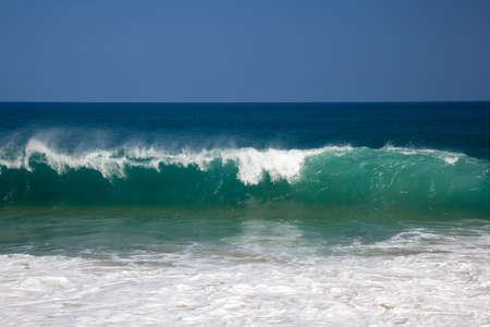 Strong waves crash over the beach at Lumahai on Kauai photo