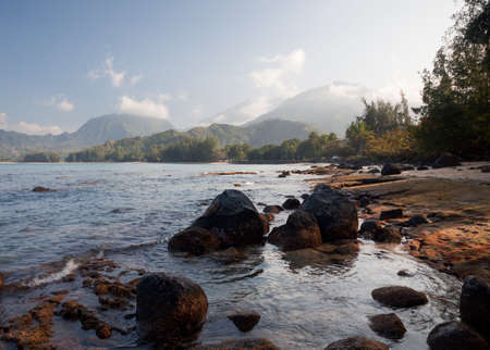Hanalei Bay at sunset looking towards the distant mountains of Kauai photo