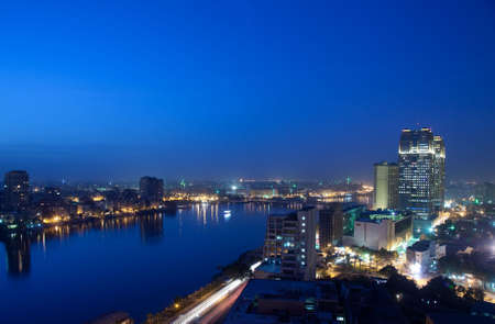 nile: Smoggy evening panorama across Cairo in Egypt with the river Nile