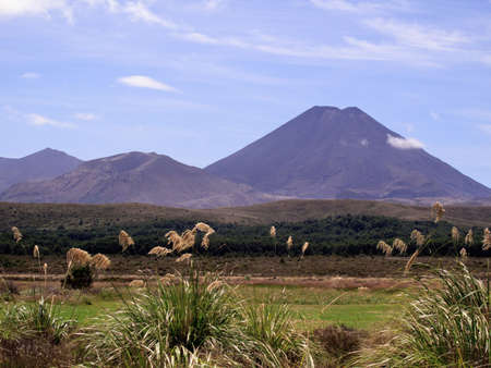 Grasses frame the volcano that was Mount Doom in Mordor in Lord of the Rings photo