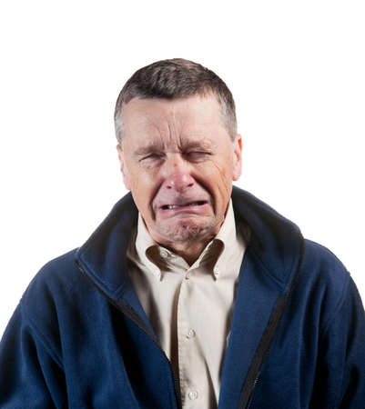 man crying: Isolated image of a middle aged man sneezing into the camera Stock Photo