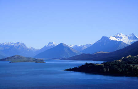 Remarkables mountain range tower over Queenstown in New Zealand photo