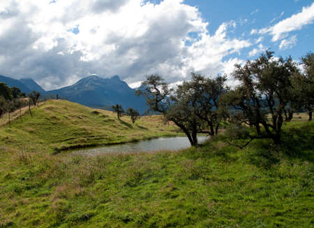 Rolling countryside valley in New Zealand with lake and mountains Stock Photo - 6832270