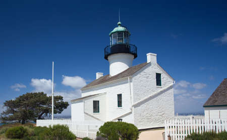 Old lighthouse on Point Loma near San Diego with a bright blue sky framing the shot Stock Photo - 7025571