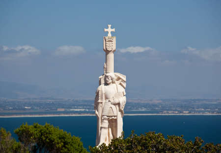 conquistador: Skyline of San Diego in background behind statue of Cabrillo on Point Loma