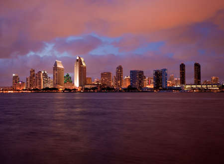 Sunset on San Diego skyline with city lights reflected in clouds taken from Coronado photo