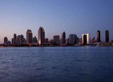 Sun setting lights up the buildings on San Diego seafront photo