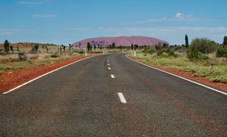 Road leading towards Ayers Rock in Australia