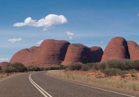 Road leading towards Ayers Rock in Australia