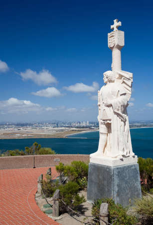 spaniard: Skyline of San Diego in background behind statue of Cabrillo on Point Loma