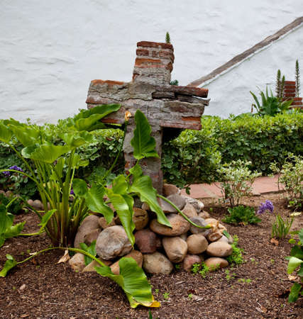 Mission San Diego de Alcala has an interior garden with a cross built from the original bricks of the Spanish Mission Stock Photo - 7223175