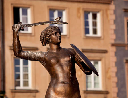 warsaw: Statue of Mermaid or Syrena in the Old Town Square of Warsaw in Poland Stock Photo