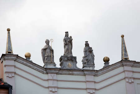 Statues on roof of old houses in the main square of Old Town in Warsaw Poland Stock Photo - 7223130