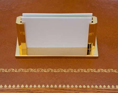 Brass business card holder on a leather desk with gold edging stock brass business card holder on a leather desk with gold edging stock photo 7282295 colourmoves