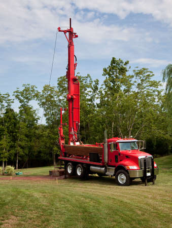 Drilling for geothermal power system in suburban yard photo