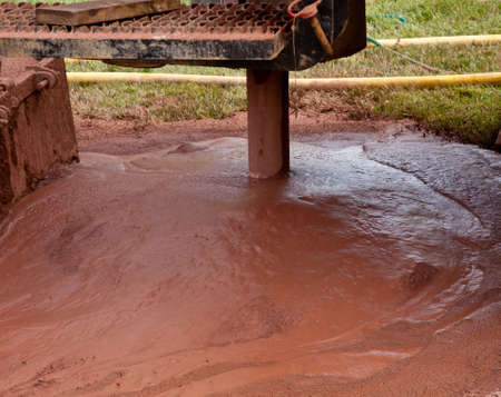 Slurry of mud from drilling for geothermal power system in suburban yard