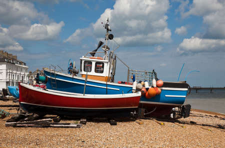 beached: Fishing boats beached on stony beach of Deal on Kent coast of England