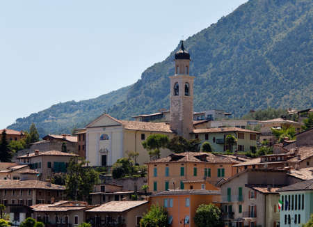 Town church above the rooftops of Limone on Lake Garda Italy photo