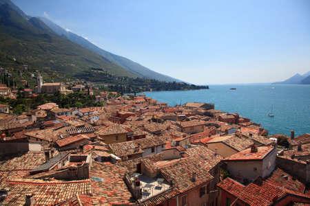 garda: View over Lake Garda over the tiled roofs of Malcesine Stock Photo