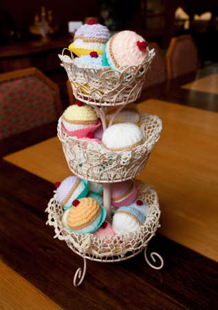Unusual knitted or crocheted cakes and buns on a white plate Stock fotó