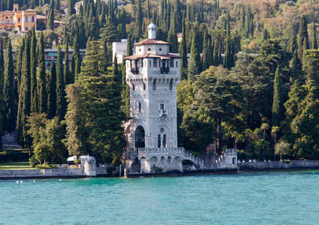 garda: Tower by Lake Garda in town of Gardone Stock Photo