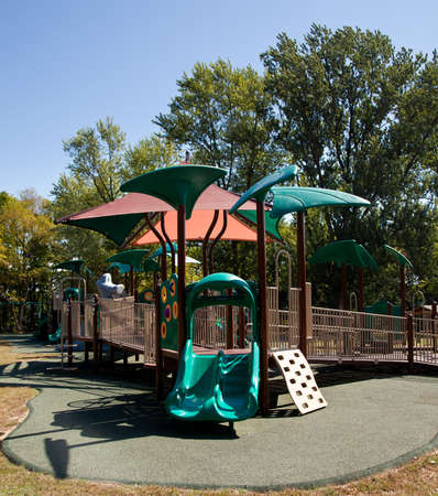 climbing frames: Modern playground for children in leafy park with slides and climbing frames