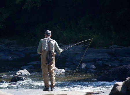 flyfishing: Fishing in Swallow Falls State Park in Maryland in rapid river
