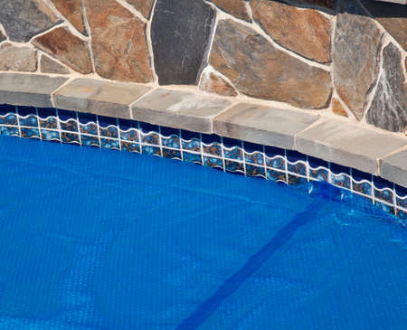Bubble wrap like pool cover pulled over a swimming pool to keep in heat overnight Stock Photo - 8004100