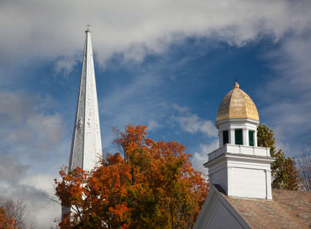 Autumnal shot of the main street of Manchester Vermont in fall as the bright trees turn orange and red photo
