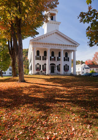 Autumnal shot of the Windham County Court House in fall as the bright trees turn orange and red photo