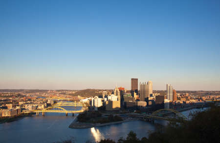 pittsburgh: Setting sun highlights the tops of the tall buildings in downtown Pittsburgh