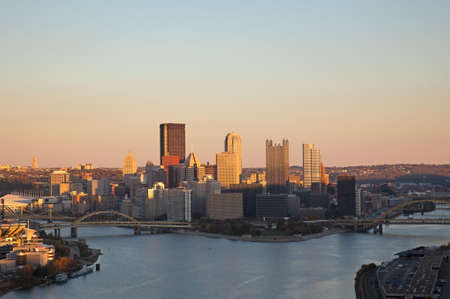 Setting sun highlights the tops of the tall buildings in downtown Pittsburgh Stock Photo - 8085579