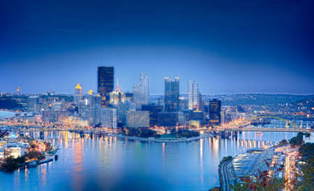 Unusual blue shaded image of Pittsburgh in the evening processed in HDR to highlight the reflections in the river photo