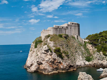 Ancient fortress on the cliff edge of Dubrovnik protects the port