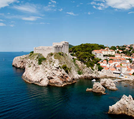 Ancient fortress on the cliff edge of Dubrovnik protects the port photo
