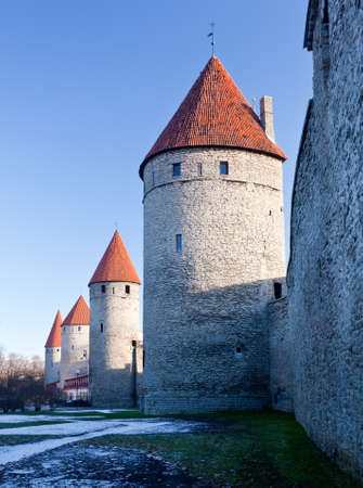 Ancient stone walls of Tallinn with four towers in alignment Stock Photo - 8287404
