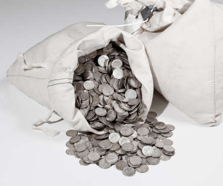 Linen bag of old pure silver coins used to invest in silver as a commodity photo