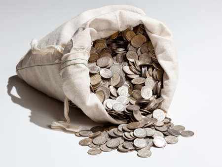 Linen bag of old pure silver coins used to invest in silver as a commodity Stockfoto