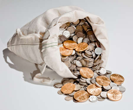 hoard: Linen bag of old pure silver coins used to invest in silver as a commodity with a selection of Golden Eagle gold coins