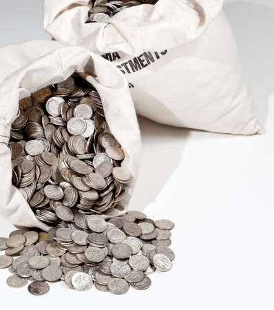Linen bag of old pure silver coins used to invest in silver as a commodity Reklamní fotografie