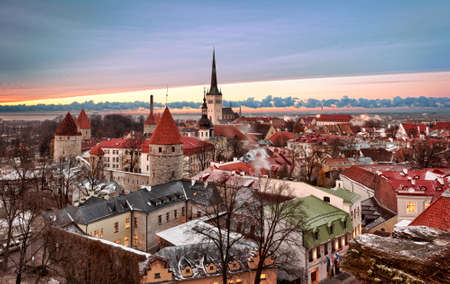 tallinn: Overview of Tallinn in Estonia taken from the overlook in Toompea showing the town walls and churches. Taken in HDR to enhance the sunset